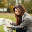 Woman feeding a goat — Stock Photo