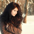 Young brunette  in winter park.  — Stockfoto