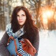 Girl walks in winter park. — Stock Photo