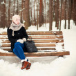 Royalty-Free Stock Photo: Woman sitting on a bench
