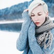 Girl dressed in sweater and scarf. — Stock Photo