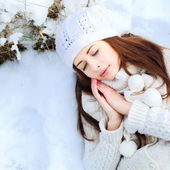 Girl sleeping in the snow — Stock Photo