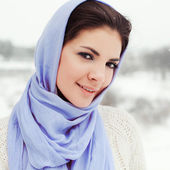 Smiling woman in blue shawl. — Stock Photo