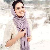 Smiling girl in winter field. — Stock Photo