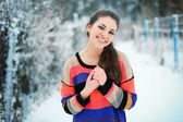 Woman, dressed in colorful sweater. — Stock Photo