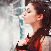 Beautiful brunette in winter with closed eyes. — Stock Photo