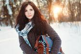 Girl walks in winter park. — Stock Photo