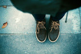 Woman's shoes on the ground. — Stock Photo