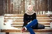 Woman sitting on a bench — Stock Photo