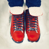 Red vintage boots on the snow. — Stock Photo