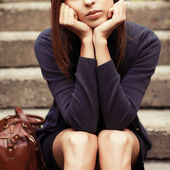 Girl sitting on the stairs alone — Zdjęcie stockowe