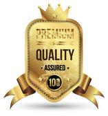 Golden premium badge with gold ribbon. — Stock Vector