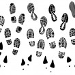 Set of vector silhouettes boots print. — Stock Vector