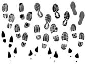 Set of vector silhouettes boots print. — Stockvektor