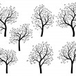 Abstract silhouettes of spring trees with leaves. — Stock Vector #26779759