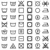 Set of icons on clothing label. — Stock Vector