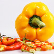 Small chili mingle with yellow paprika - Stock Photo