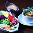 Completed lunch salad and tomyam - Stock Photo