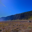 Meadow at bromo, hill back ground, clear blue sky — Stock Photo