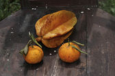 Rotten fruits on the obsolescent teak chair — Stock Photo