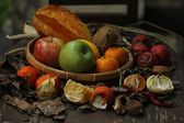 Some fruits and rotten vegetables on the teak chair — Stock Photo