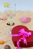 Valentine ribbon box and a glass of wine, white back ground — Stock Photo