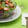 Green salad, vegetable and fruit, isolated on green background — Stock Photo