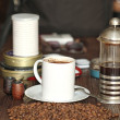 Cup of coffee on the rustic table — Stock Photo