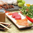 Stock Photo: Japanese food: sashimi and sushi rolls
