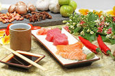 Japanese food: sashimi and sushi rolls — Stock Photo