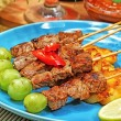 Food: ribs soup, cakes, beef satay — Stock Photo #32233597