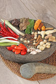 Spices on mortar — Stock Photo