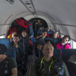 Stock Photo: Passangers aboard plane during Antarctic Expedition