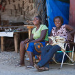 Two local women sitting near a house in Namibian village — Stock Photo #18037899