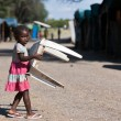 Local little girl carrying chair in NamibiVillage — Stock Photo #18038043
