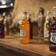 Bottles of Route 66 sodas on a bar counter, USA - Stock Photo