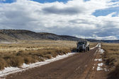 Truck over the Colorado severe landscape — Stock Photo