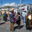 Buying poncho on the street of Quito city, Ecuador - Stock Photo