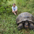 Tourist and Galapagos Giant Turtle — Stock Photo