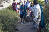 Group of tourists on Galapagos Islands — Stock Photo