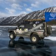 SUV truck on winter Baikal lake — Stock Photo