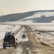 SUV trucks on winter Baikal lake - Stock Photo
