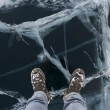Walk on cracked ice of Baikal lake — Stock Photo