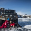 Stock Photo: Photo by SUV truck on winter Baikal lake