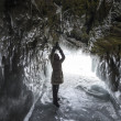 Stock Photo: Woman inside Ice grotto on Baikal lake