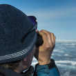 Watching binocular on Baikal lake in winter — Stock Photo