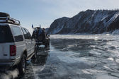 SUV trucks on winter Baikal lake — Stock Photo
