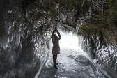 Woman inside Ice grotto on Baikal lake — Stock Photo