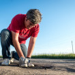 Repairing road with cold-mix asphalt on a rural russian road — Stock Photo