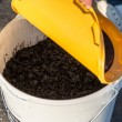 Cold mix asphalt in a bucket — Stock Photo